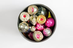 Colorful Vintage Christmas ornaments in iron pot on white backgr Stock Image