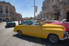 Colorful vintage classic cars in front of Grand Theatre Havana, Cuba royalty free stock photos