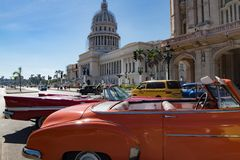 Colorful vintage classic cars in front of Grand Theatre Havana, Cuba royalty free stock images