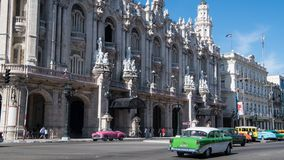 Colorful vintage classic cars in front of Grand Theatre Havana, Cuba stock photo