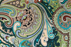 Colorful vintage fabric with blue and brown paisley print. Horizontal image Stock Image