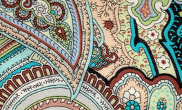 Colorful vintage fabric with blue and brown paisley print Royalty Free Stock Images