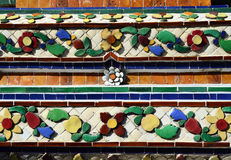 Colorful vintage flower ceramic tile decoration at buddhist temp Stock Photos