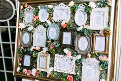 Colorful vintage frames with the list of the wedding guests. A stock image