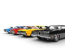 Colorful vintage muscle cars in a row Royalty Free Stock Images