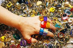 Colorful Vintage Rings. A woman tries on many rings from a huge vintage pile Stock Image