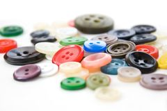Colorful vintage sewing buttons on white Stock Photo