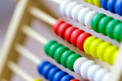 Colorful vintage style wooden abacus. For Learning Basic Mathematics Calculator - Close up.  stock photos