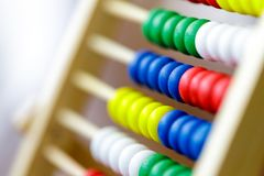 Colorful vintage style wooden abacus. For Learning Basic Mathematics Calculator - Close up.  royalty free stock photo