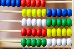 Colorful vintage style wooden abacus. For Learning Basic Mathematics Calculator - Close up.  stock images