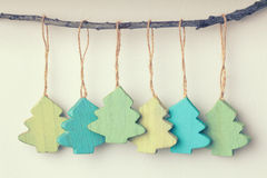Colorful  vintage wooden christmas trees hanging Royalty Free Stock Photo