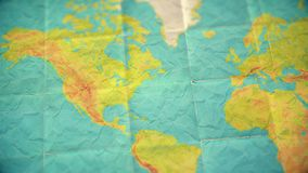 Colorful vintage world map - zoom in to North America - blank version. Zoom in from World Map to North America. Old well used world map with crumpled paper and stock video