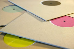 Colorful vinyl records. Pile of cardboard sleeve vinyl music records with colorful blank labels Royalty Free Stock Photos