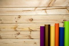 Colorful vinyl rolls on wooden background royalty free stock images