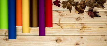 Colorful vinyl rolls on wooden background stock images