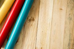 Colorful vinyl rolls on wooden background. A Colorful vinyl rolls on wooden background with your necessary instruments royalty free stock photo