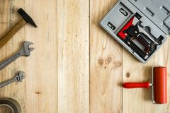 Different working and repair tools on a wooden background. With space for text stock photo