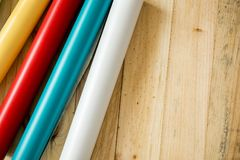 Colorful vinyl rolls on wooden background. A Colorful vinyl rolls on wooden background with your necessary instruments royalty free stock image