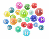 Colorful vitamin capsules isolated on white Royalty Free Stock Photo