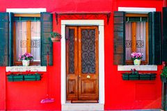 Burano. Colorful vivd red  house in the old town of Burano, a little island  in Venice lagoon, Italy Stock Photo