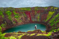 Colorful volcanic crater filled with blue water, Iceland. Summer time Royalty Free Stock Photos