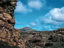 Colorful volcanic landscape with lava fields in the foreground. Lanzarote, Canary Islands royalty free stock photography