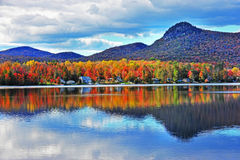 Colorful VT Autumn reflection ablaze surrounded by drearie hills HDR Royalty Free Stock Image
