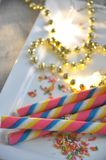 Colorful Wafer Roll on White Plate Royalty Free Stock Photos