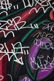 Colorful wall graffiti in the city stock images