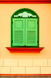 Colorful wall with green window stock photo