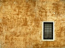 Colorful wall of a house on Venice. Texture of ancient wall Royalty Free Stock Photos
