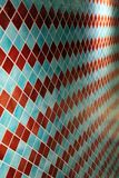 Colorful wall tiles in an interesting arrangement. Colorful wall tiles in red and blue with interesting patterns and repetitive arrangement royalty free stock images