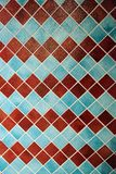 Colorful wall tiles in an interesting arrangement. Colorful wall tiles in red and blue with interesting patterns and repetitive arrangement stock image