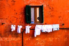 Colorful wall & window with drying clothes Stock Photography
