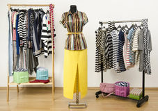 Colorful wardrobe full of clothes and accessories with stripes pattern. Royalty Free Stock Photo