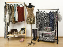 Colorful wardrobe with jungle pattern clothes and accessories. Royalty Free Stock Image