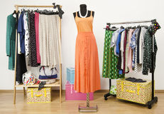 Colorful wardrobe with polka dots clothes and accessories. Stock Photos