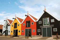 Colorful warehouses in Dutch harbor. Colorful warehouses in Dutch little harbor at Zoutkamp Stock Photos
