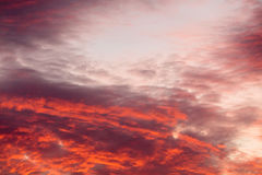 Colorful warm clouds on sky at sunset Royalty Free Stock Photo