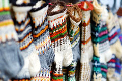 Colorful warm knitted socks sold on Easter market in Vilnius Royalty Free Stock Photos