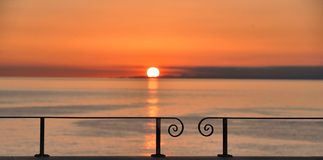Colorful warm orange sunset on Mediteranian sea looked from train station in Manarola, Cinque Terre in liguria, nothern italy royalty free stock photography