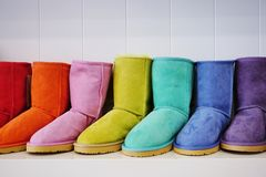 Colorful warm sheepskin Australian boots. Warm, fuzzy sheepskin Australian boots in many colors are lined up Stock Images