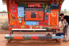 Colorful warning signs, street art at Uluru Ayers Rock. Colorful warning signs, designed by the Nyangatjatjara College in Yulara. The warning signs prevent Royalty Free Stock Images