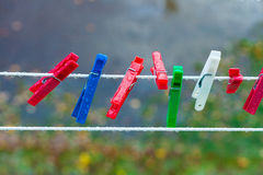 Colorful washing laundry clips on strip outdoor. Background. Royalty Free Stock Images