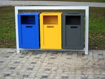 Colorful waste baskets in metal frame Stock Photos