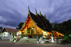Colorful Wat Xieng thong temple at dusk in Luang Prabang, Loas stock image