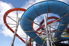 Colorful water aqua park pipe on blue sky background Stock Photo