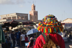 Colorful water bearer in main square of Marrakech Royalty Free Stock Images