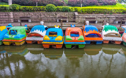 Colorful water bike pedal boats for recreation Royalty Free Stock Image
