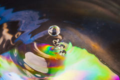 Colorful Water drop. Close up Stock Photography